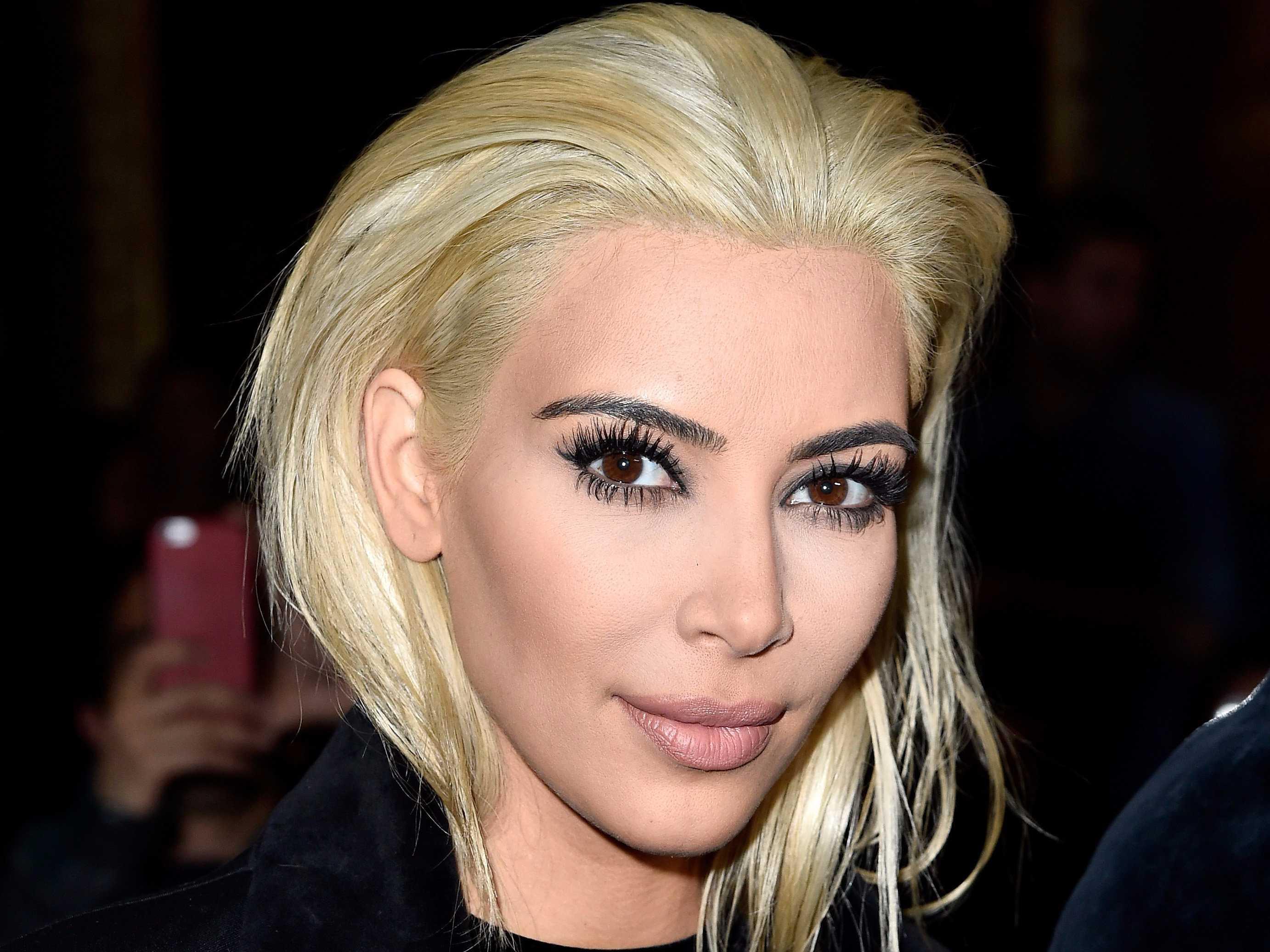 Katy Perry Is Stone-Faced While Posing Next to Kim Kardashian, Kanye West in Paris